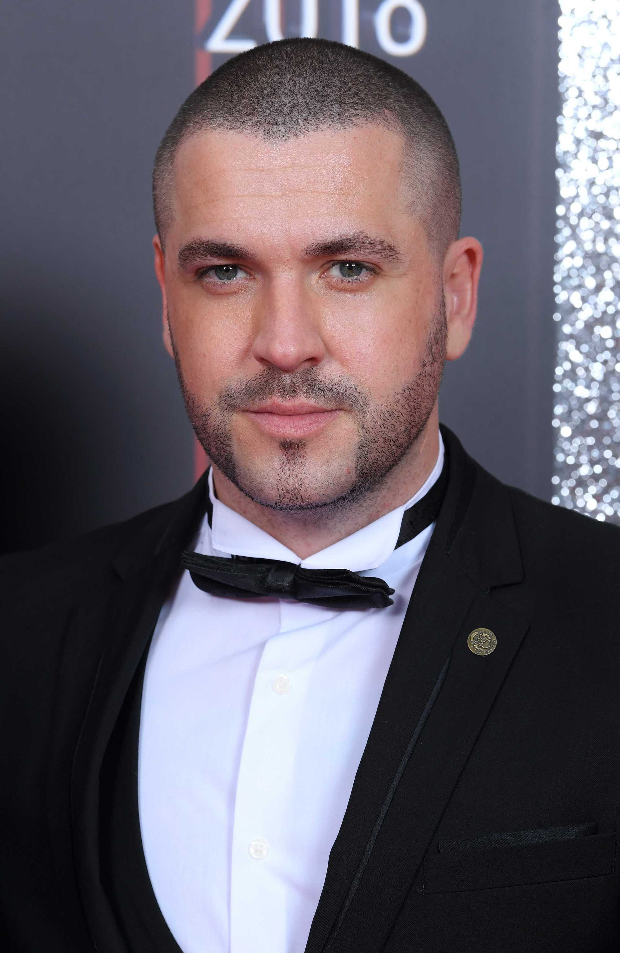 Hairstyles for receding hairline: Headshot of Shayne Ward with a buzz cut, wearing a tux