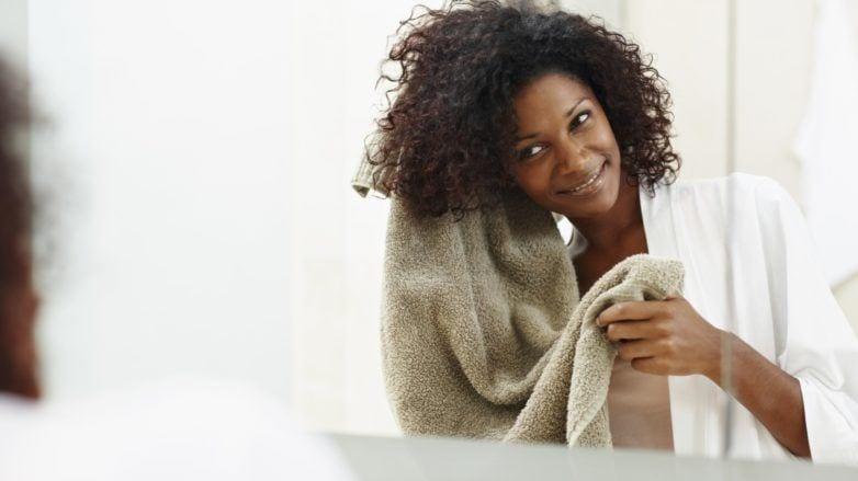 black woman doing a pre-poo dry hair treatment