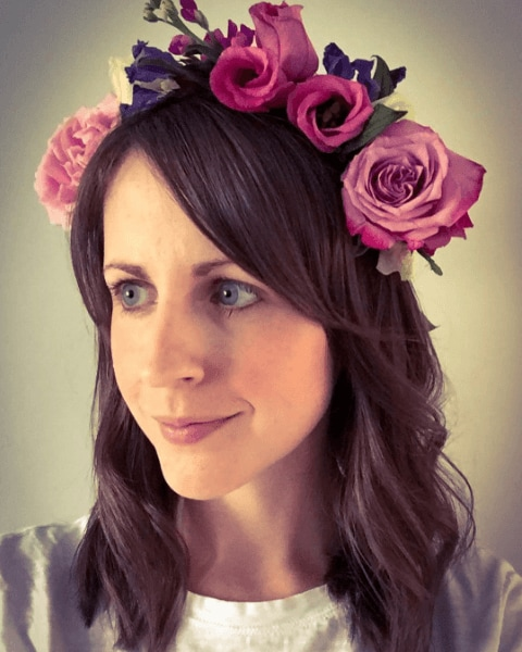 Festivals accessories: woman with a pink flower garland in medium length brown hair