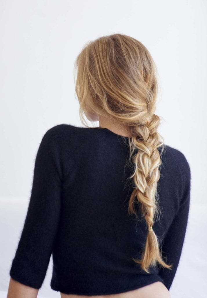 Easy summer hairstyles: blonde woman with single 3 strand braid