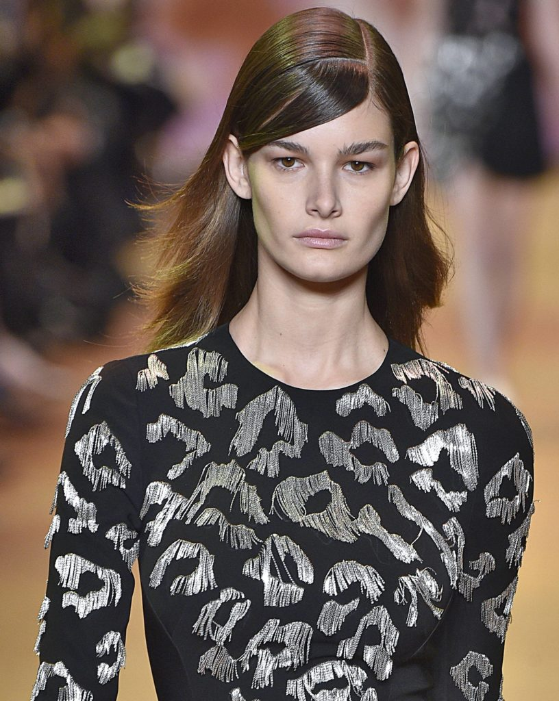 Hair parting: Mugler Paris dark brown hair with side parting and parted fringe