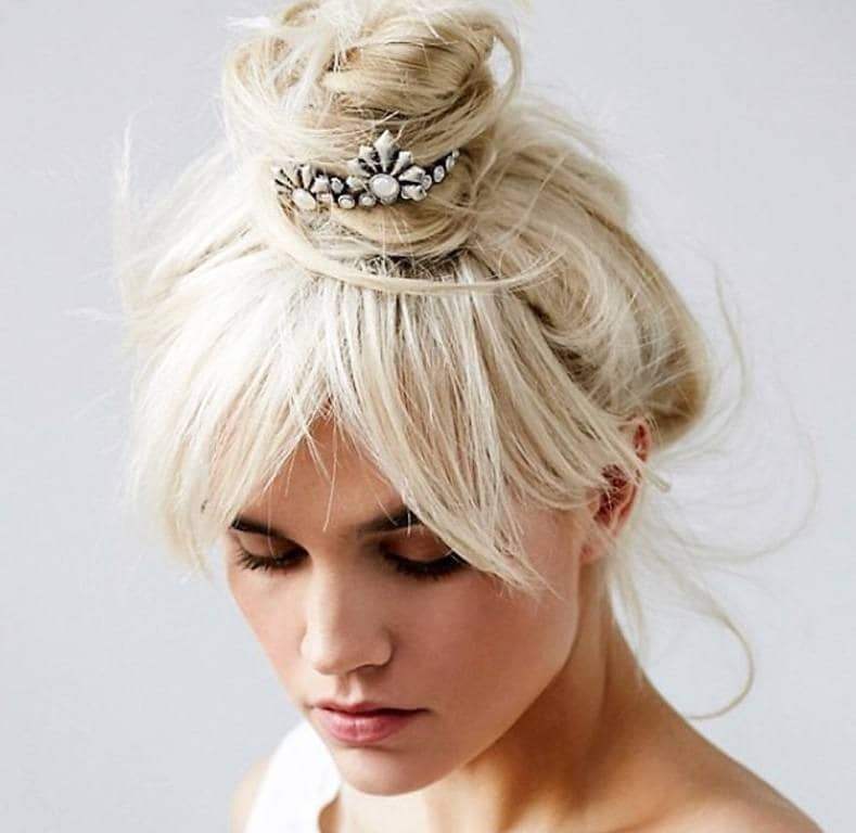 woman with blonde hair styled into an updo with bun cuff