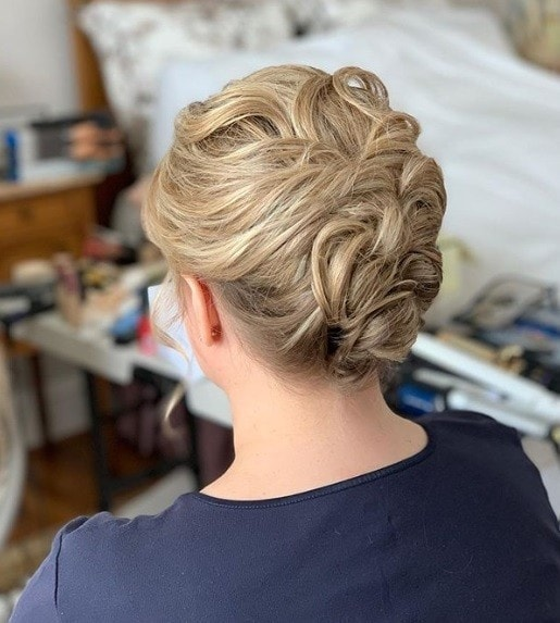 Blonde woman with a curly pinned wedding updo
