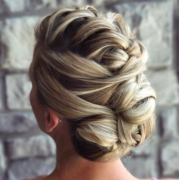 Wedding hairstyles for long hair: Back view of a blonde woman with her hair in a French fauxhawk updo hairstyle