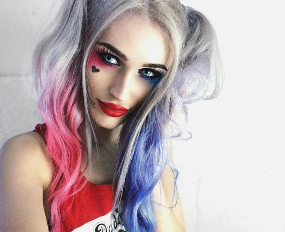 woman with light grey hair dressed as Harley Quinn