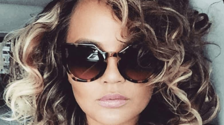 1980s hairstyles Chrissy Teigen new curly hair