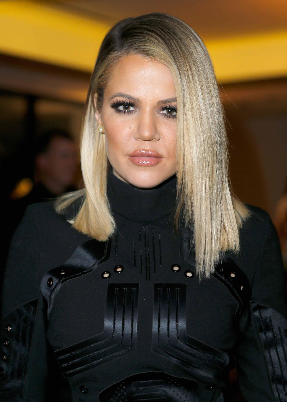 khloe kardashian blonde straight side part long bob