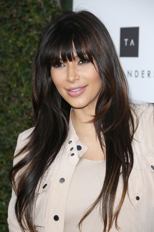 Kim Kardashian dark brown long hair with full bangs