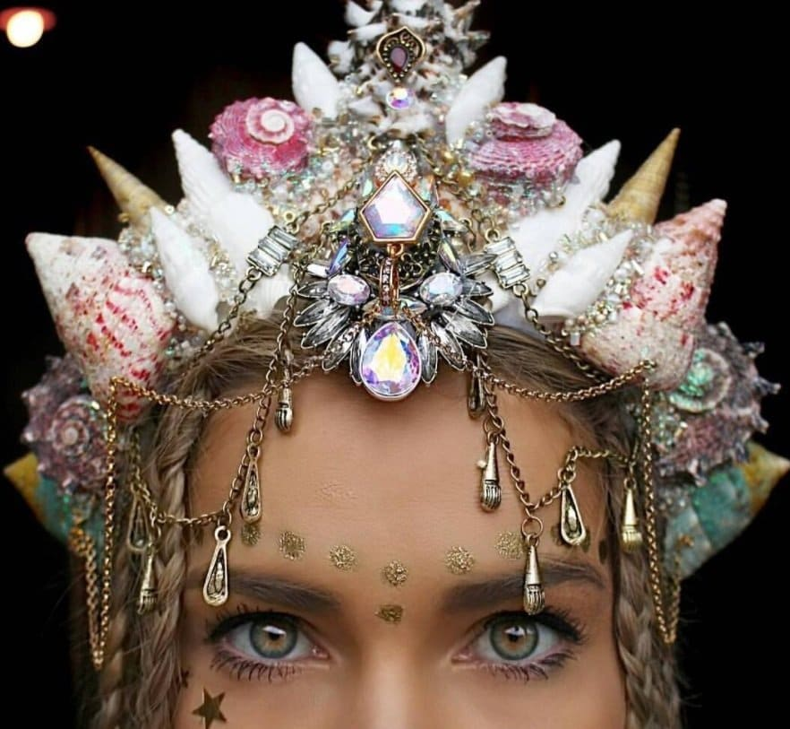 woman with mermaid crown hairstyle and glittery makeup