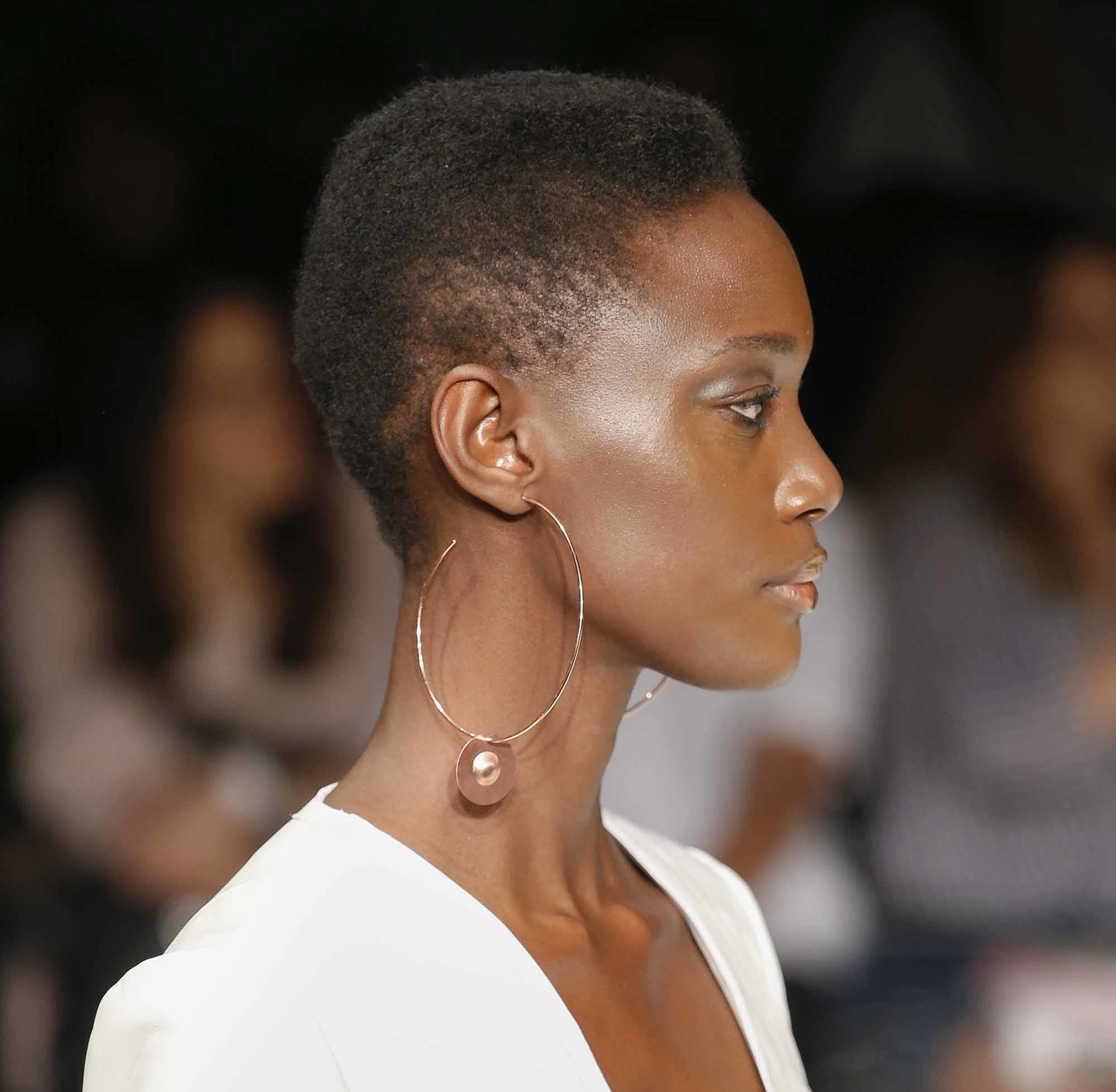 side profile of model with short mohawk afro natural brown hair and oversized hoop earrings at aw16 fashion week show