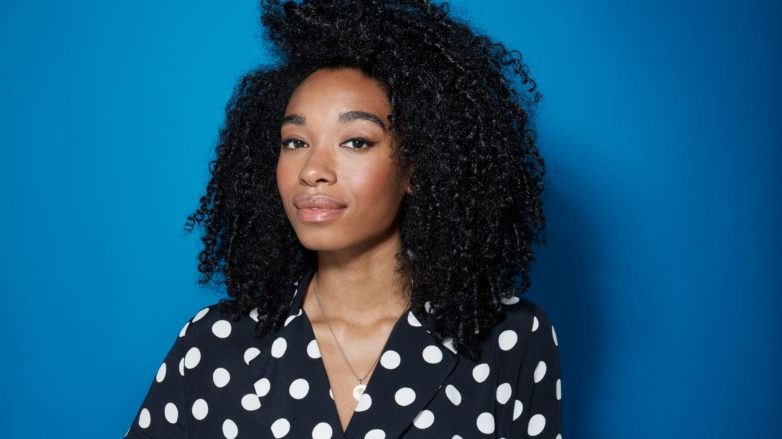 World Afro Day: A young black woman with natural hair and polka dot top