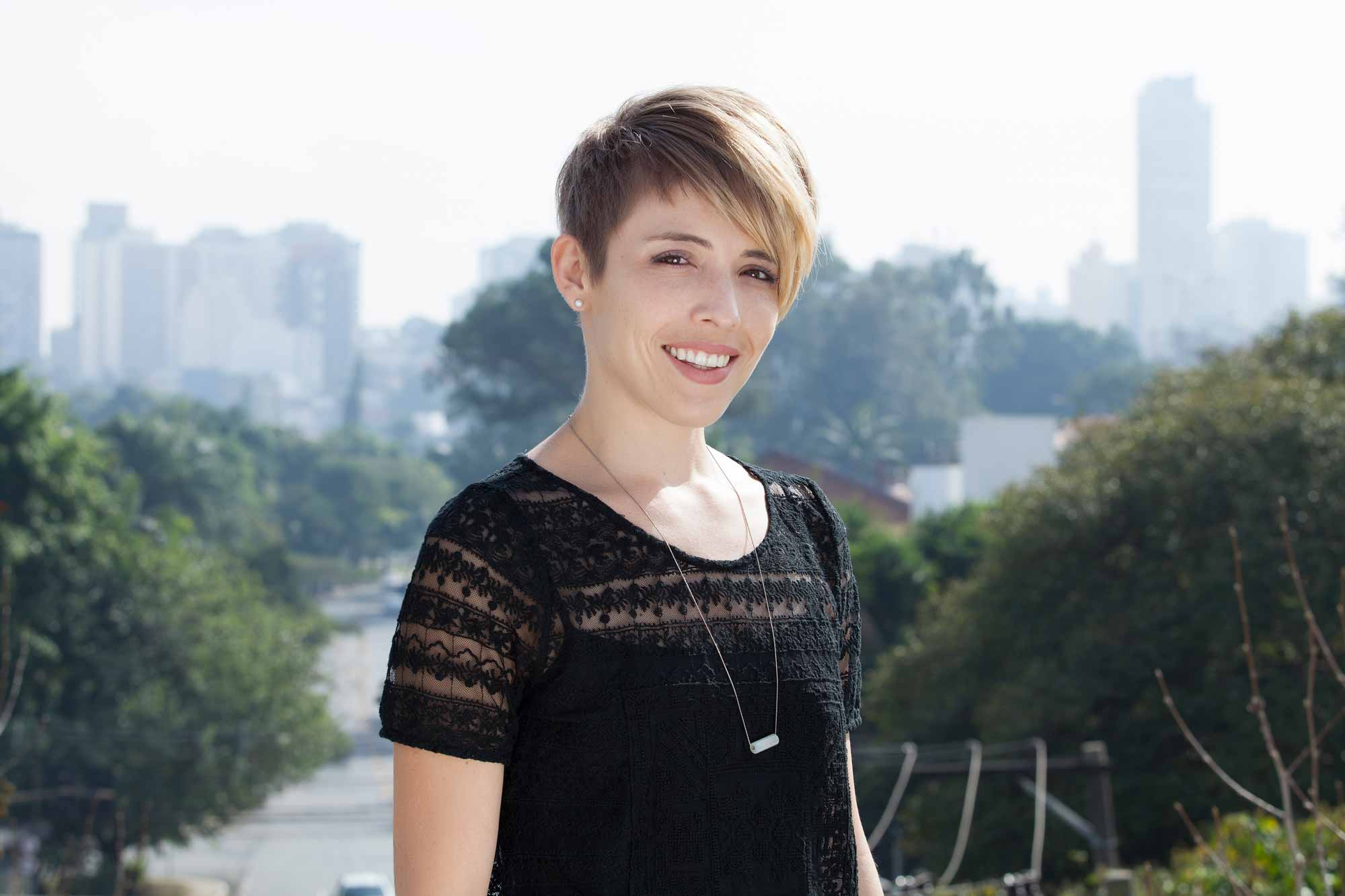 Hairstyles for round faces: Woman with short asymmetric fade pixie cut
