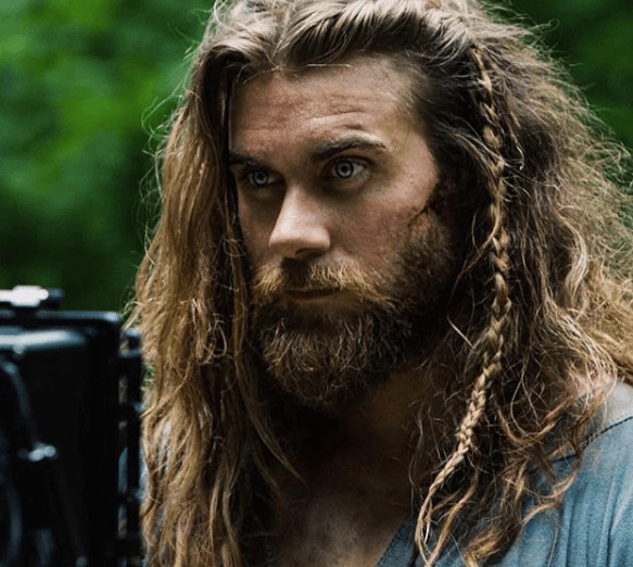 Brock O'Hurn with long hair and braids
