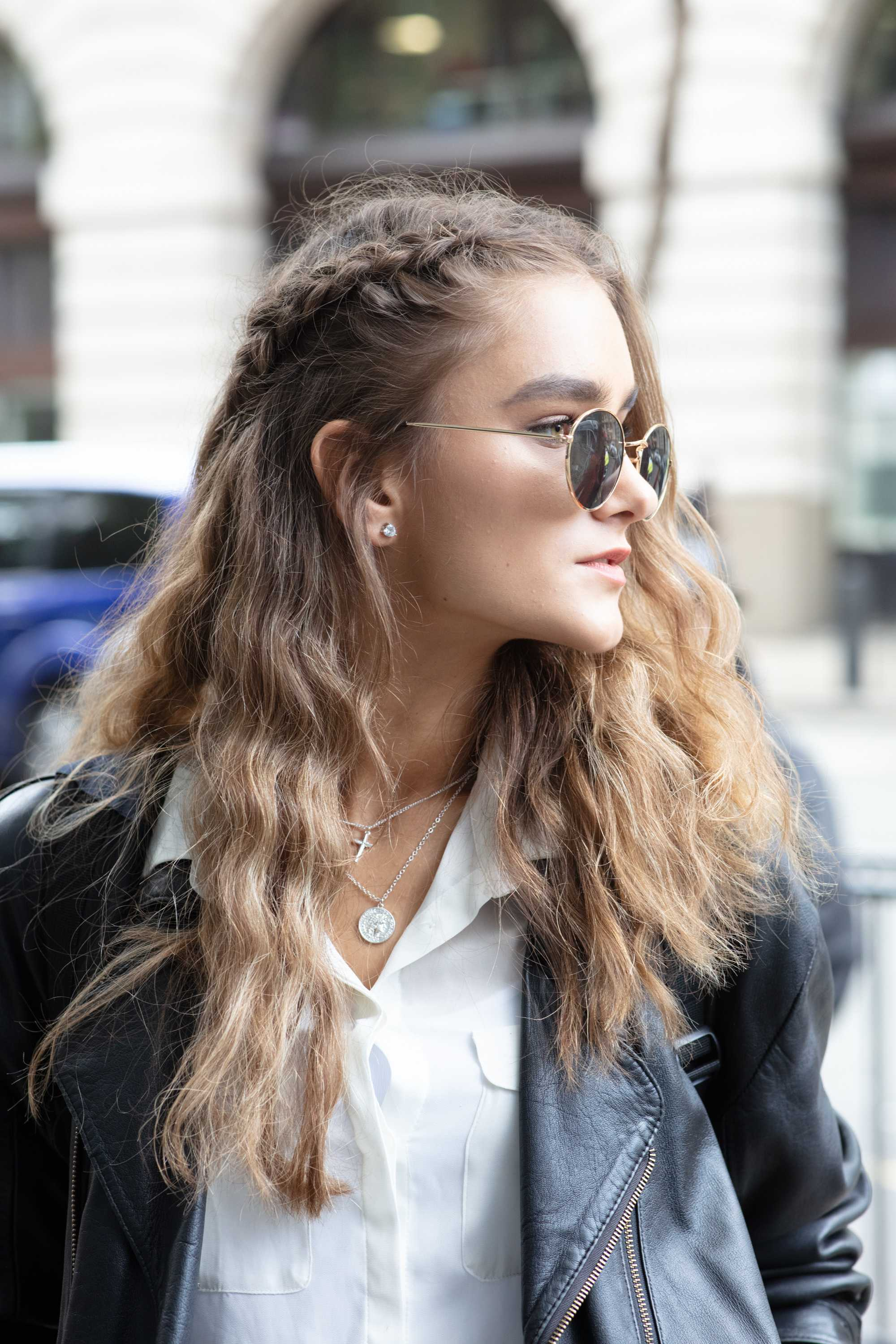Thick hairstyles: Woman with long dark brown thick hair styled into waves with a side braid