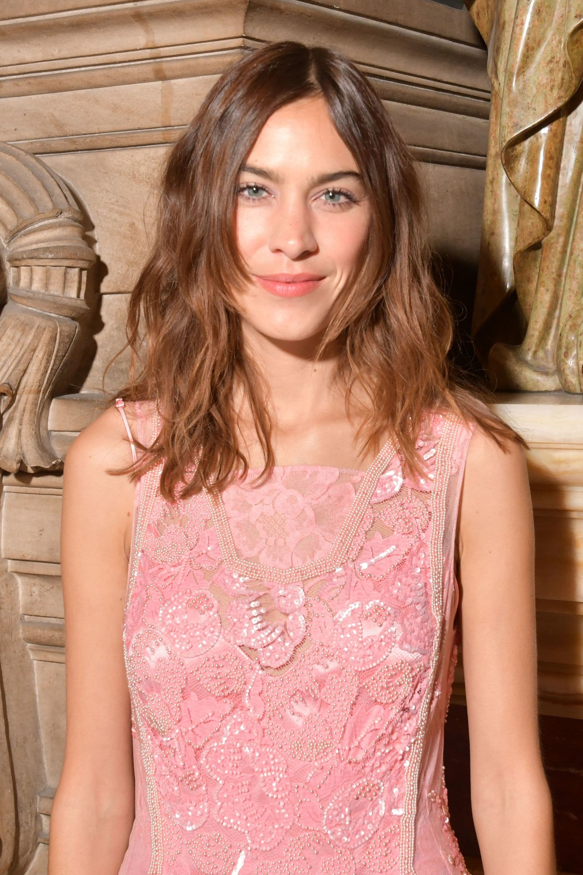 Medium hairstyles for thick hair: Alexa Chung with shaggy brunette hair with short face-framing layers
