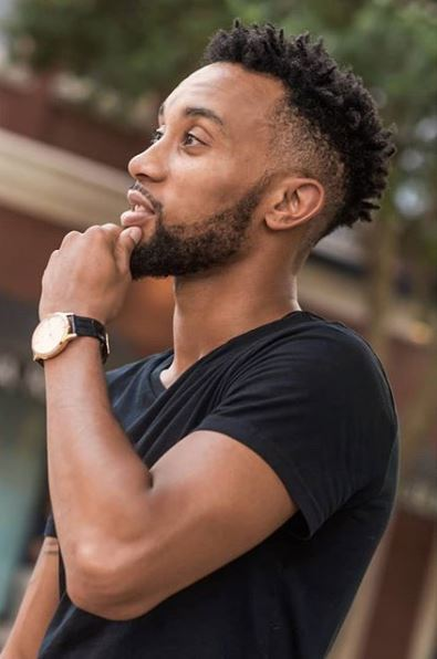 black man touching his chin with a frohawk hairstyle from Instagram @dreasvision