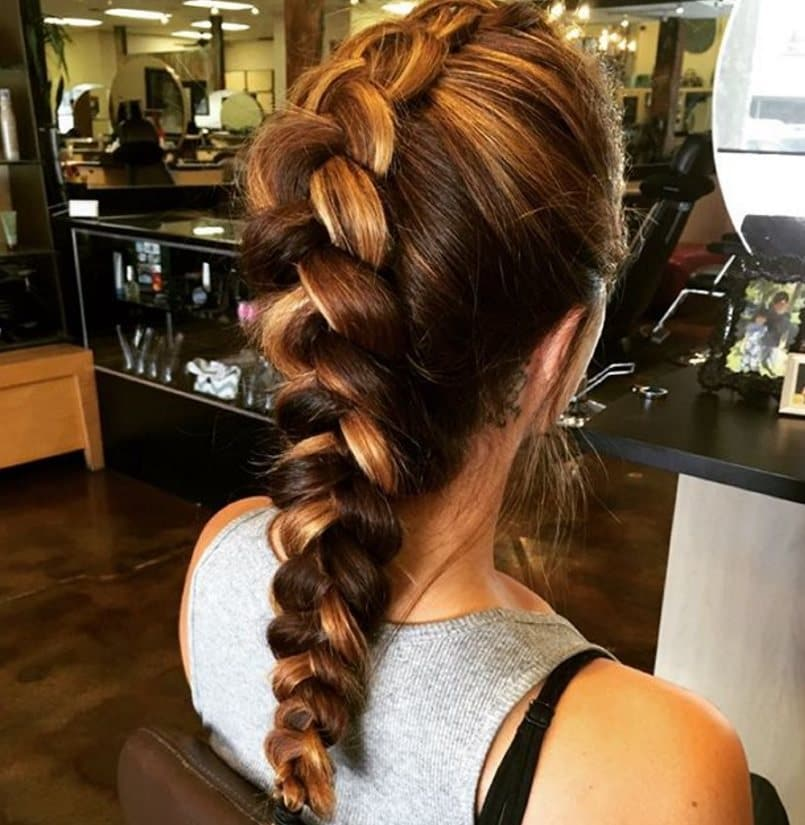 back view image of a woman with a french braid faux hawk braid with two tone hair