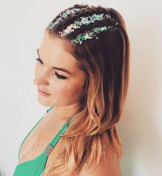 Dutch braid hairstyles: Woman with her hair in Dutch braid half-up cornrows with glitter roots