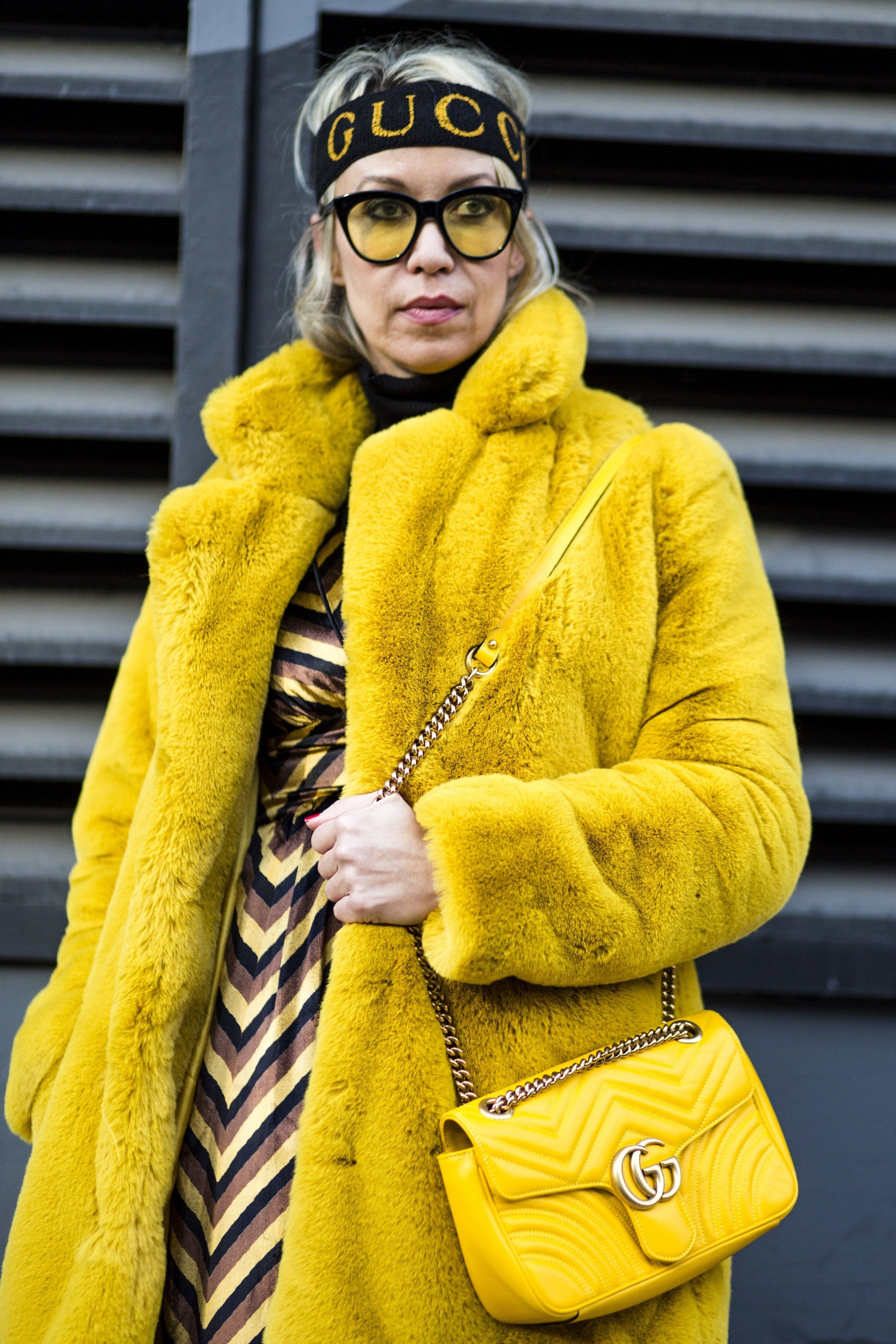 nyfw street style model in an all yellow outfit with a sporty gucci headband