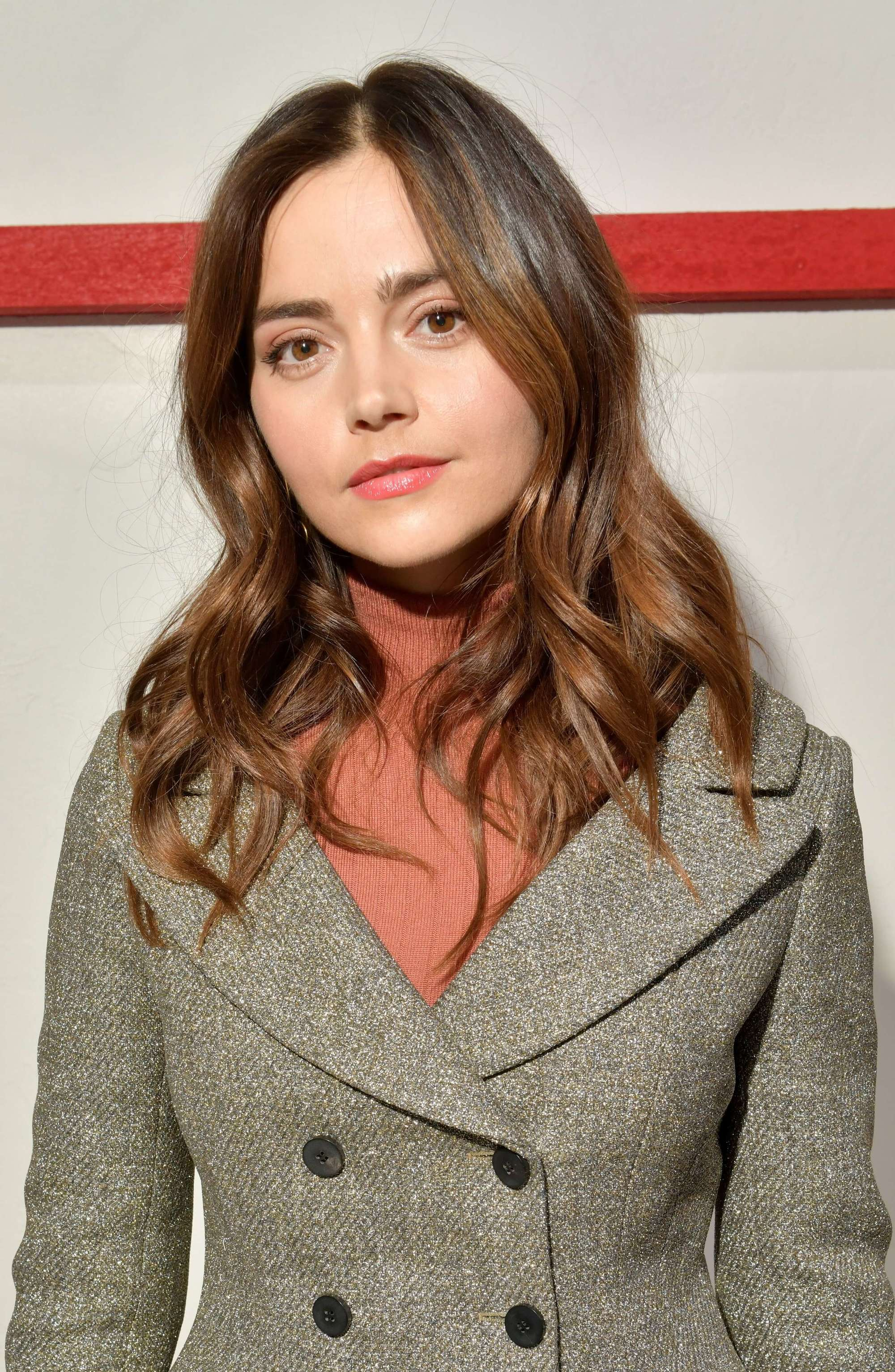 Medium hairstyles for thick hair: Jenna Coleman with wavy brown shoulder length hair
