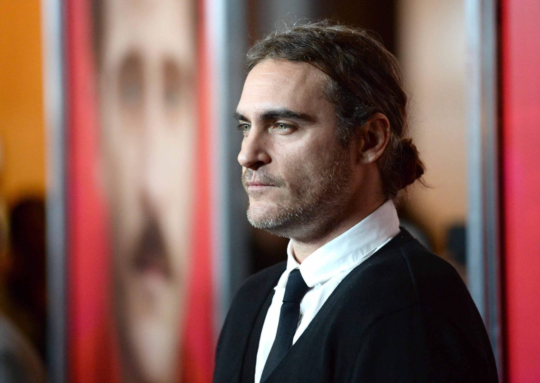 man bun Joaquin Phoenix hair