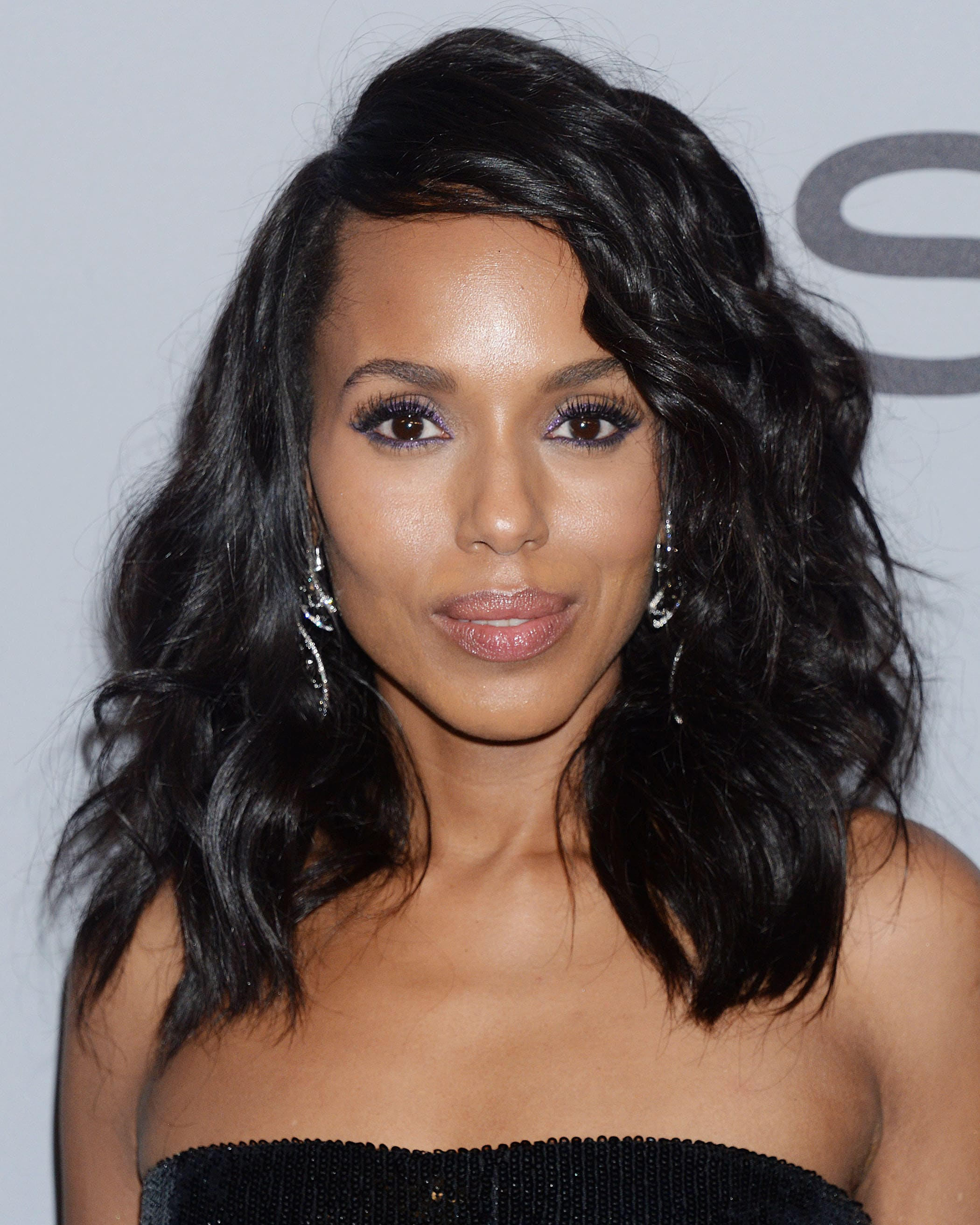 Medium hairstyles for thick hair: Kerry Washington with shoulder-length dark hair in a side parting with waves