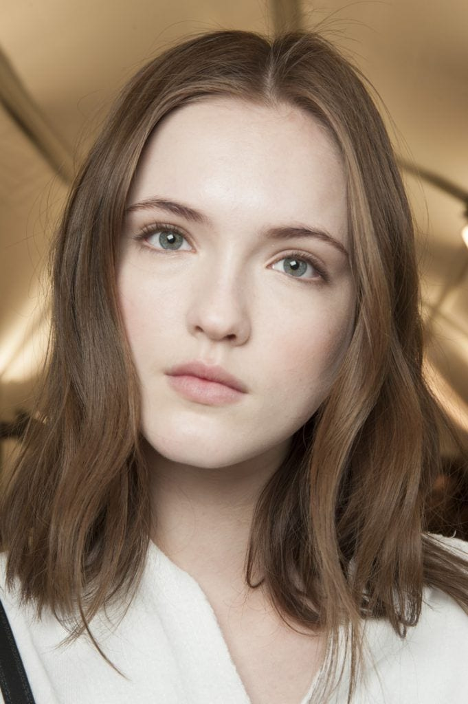model with natural light brown hair backstage shot