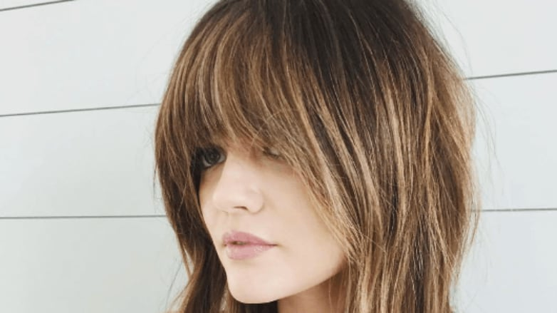 pretty little liars actress lucy hale with a shaggy brunette cut and soft full bangs