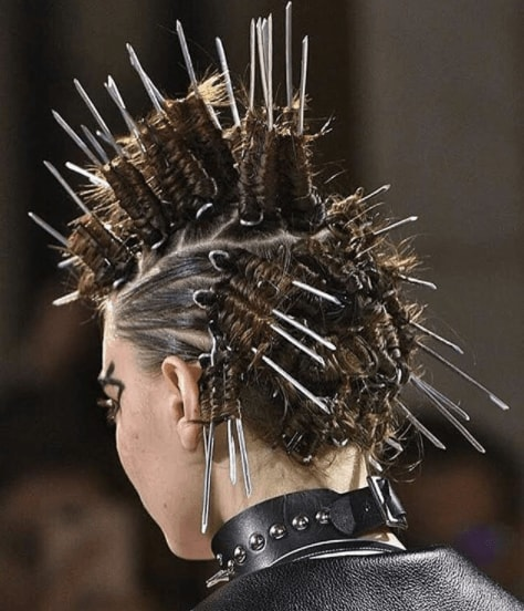 back view of a woman's hair with pins and braids - faux hawk braid
