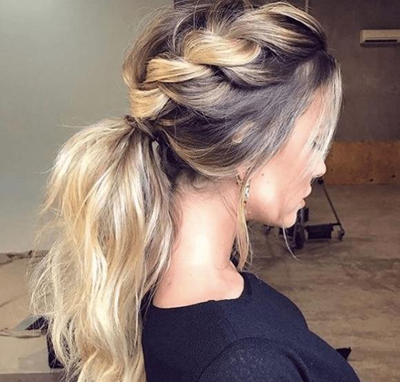 back view of a woman's blonde hair in a loose braid - faux hawk braid