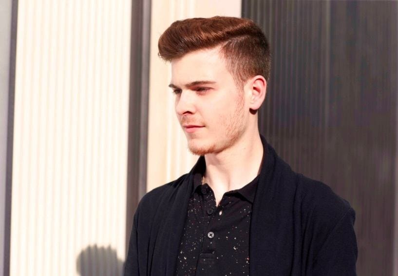 front view of a man with red hair and a classic undercut hairstyle