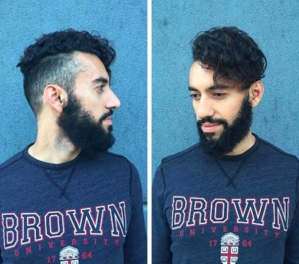 front view of a man with black hair a beard and an undercut