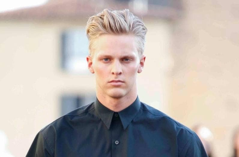 front view of a man with blonde hair a quiff and an undercut