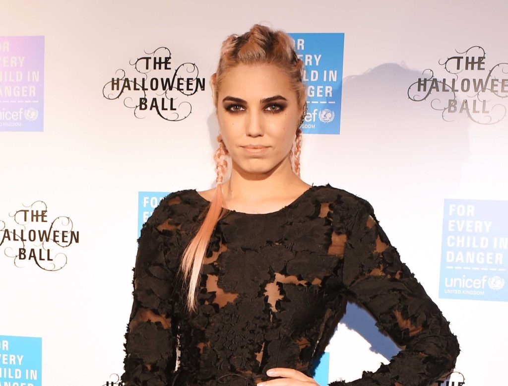 Amber Le Bon on the red carpet of the unicef halloween ball wearing pink braids in her long hair