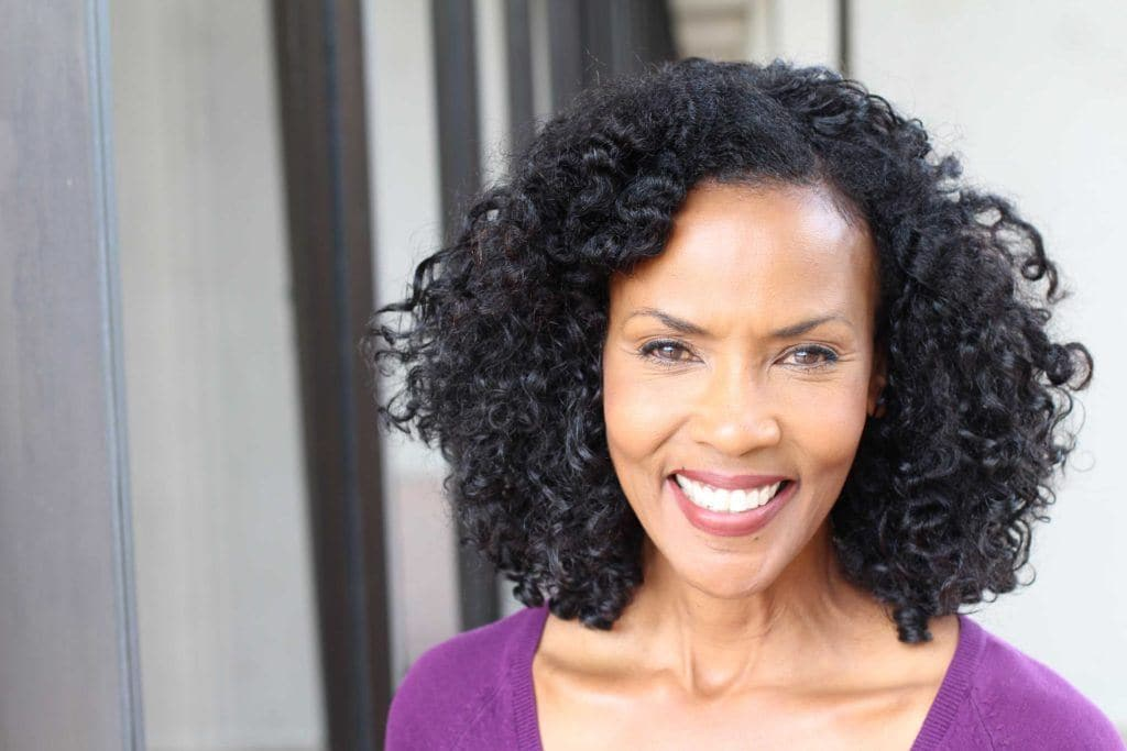 short hair for over 50 can be styled like this natural-haired lady