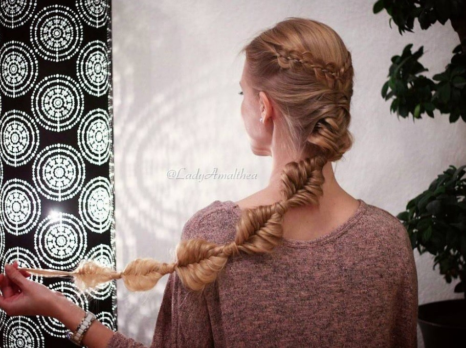 Disney hairstyles: Back view of a woman with long bronde hair in a Rapunzel style braid