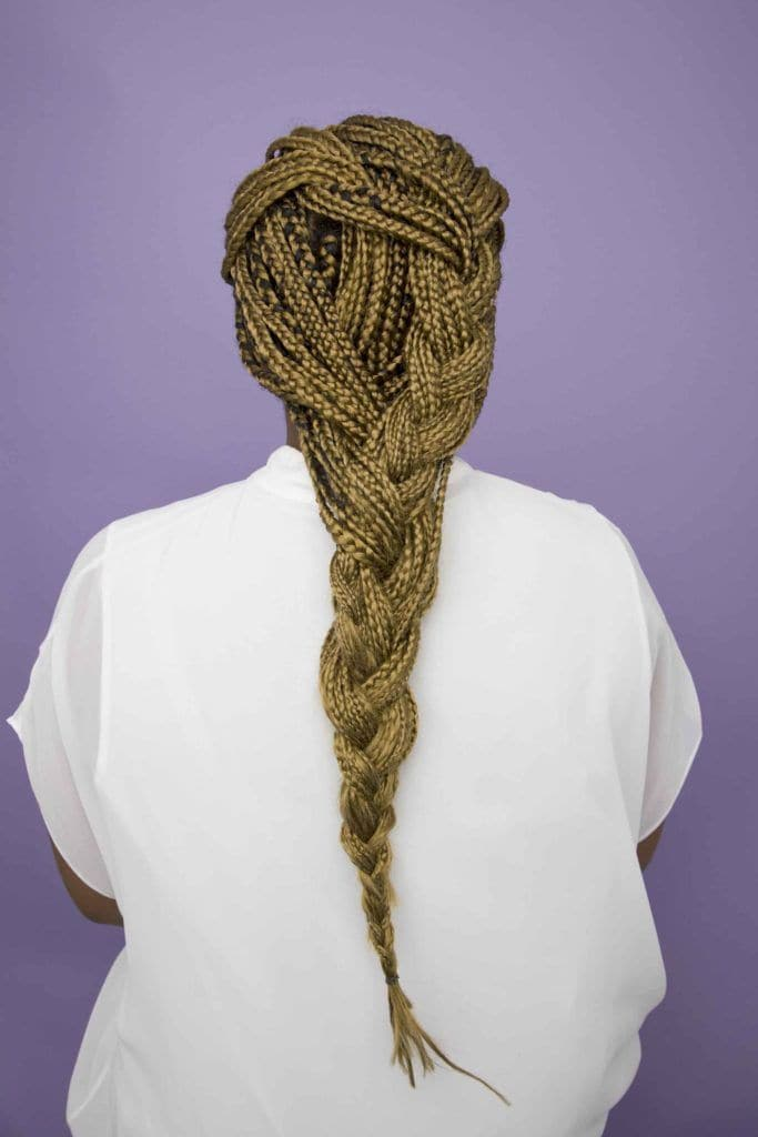 back view of a woman's head with long party braid box braids - going out hairstyles
