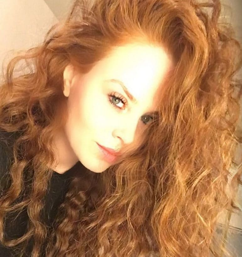 Disney hairstyles: Close-up selfie of a red head with long curly hair like Merida in Disney's Brave