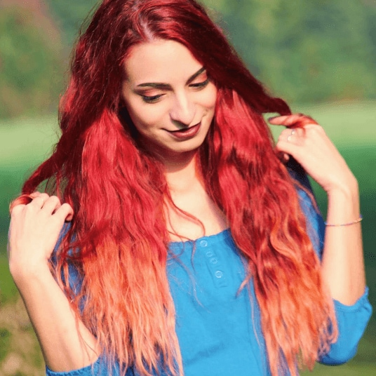 image of a woman with multiple shades of red hair