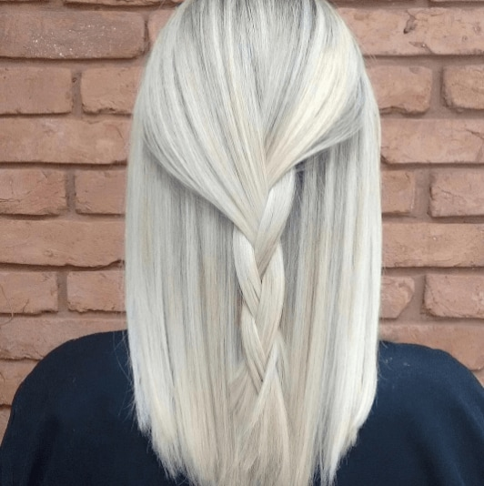back view of a woman with white hair with grey highlights