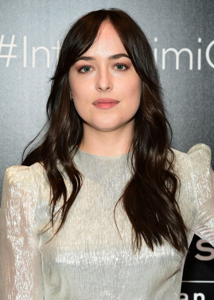 image of Dakota Johnson with her hair worn long and dark - blonde brown hair