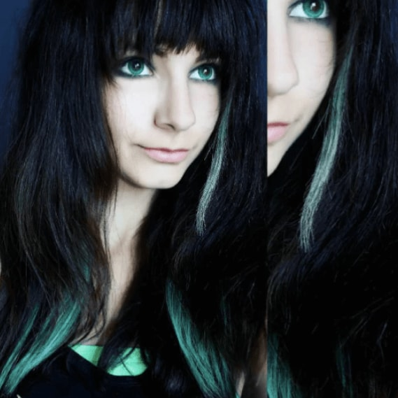 front view of a girl with long dark hair and bright coloured highlights - goth hairstyles