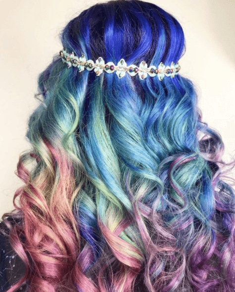 Unicorn hair: Back view of multicoloured ombre purple mint mauve and purple curly hair with a boho headband