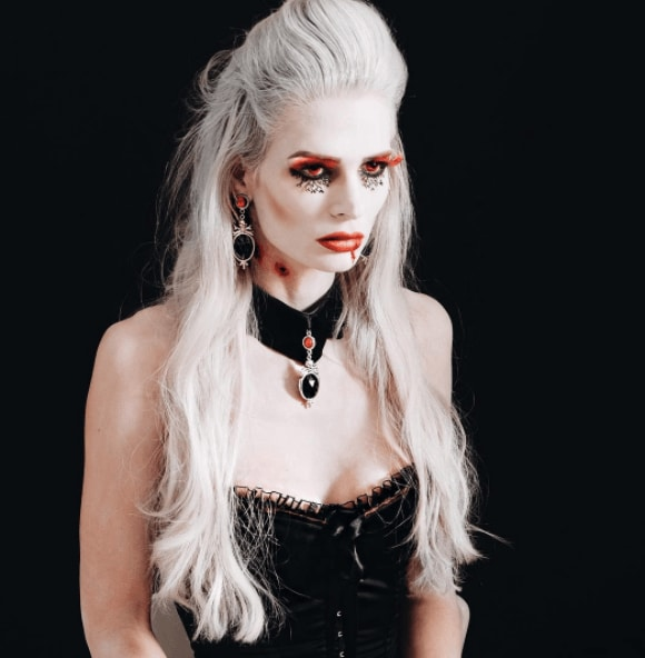 front view of a woman with long white hair, half up, half down - vampire hairsytles