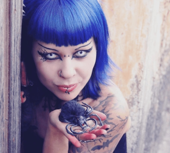 front view of a woman with dark blue vampire style hair