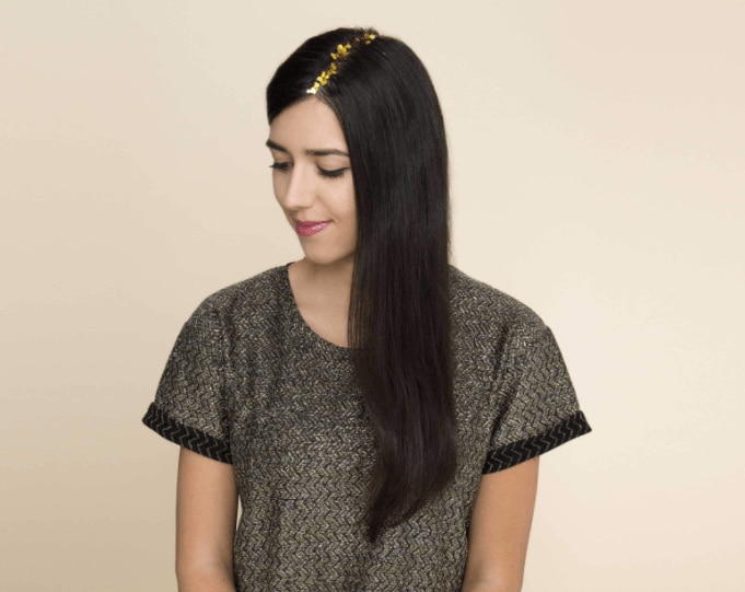 image of a woman with long dark hair and glitter roots - going out hairstyles