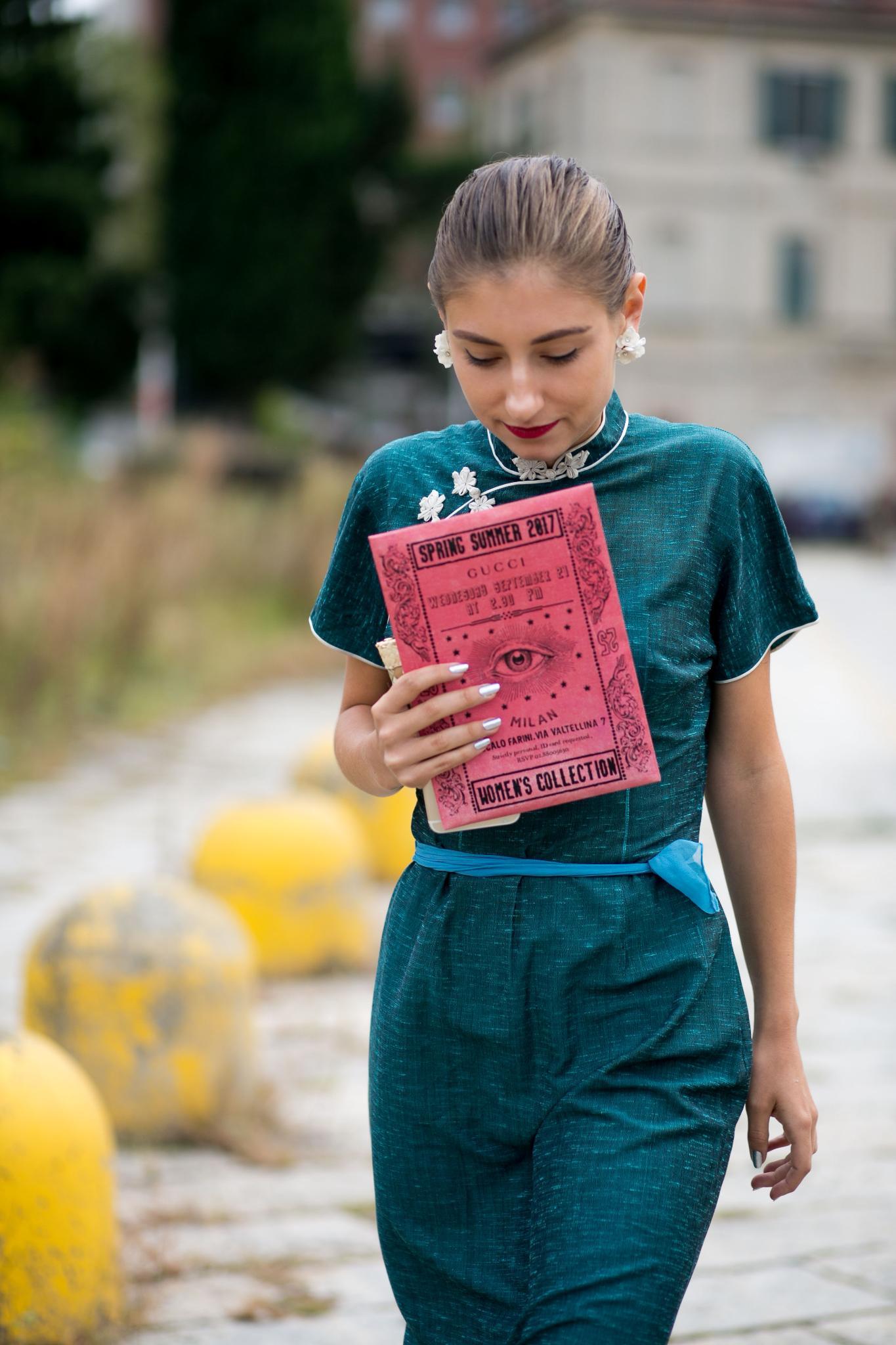 Short cuts: Beautiful young woman with a sleek bun at Fashion Week