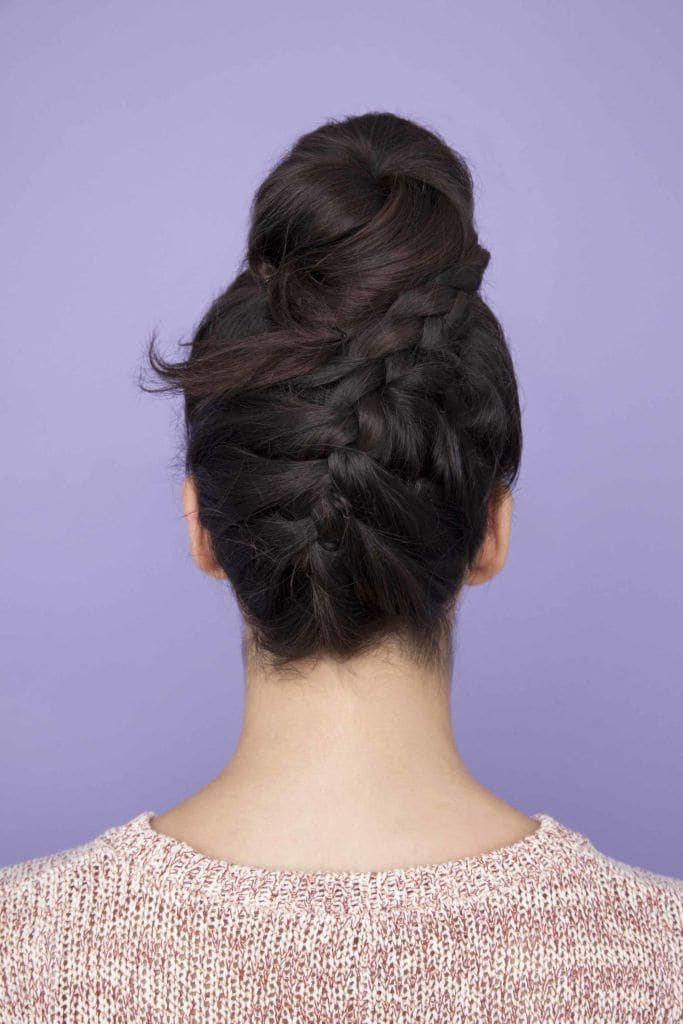 back view of a womans dark hair with an upside down French braid brown french braid - going out hairstyles