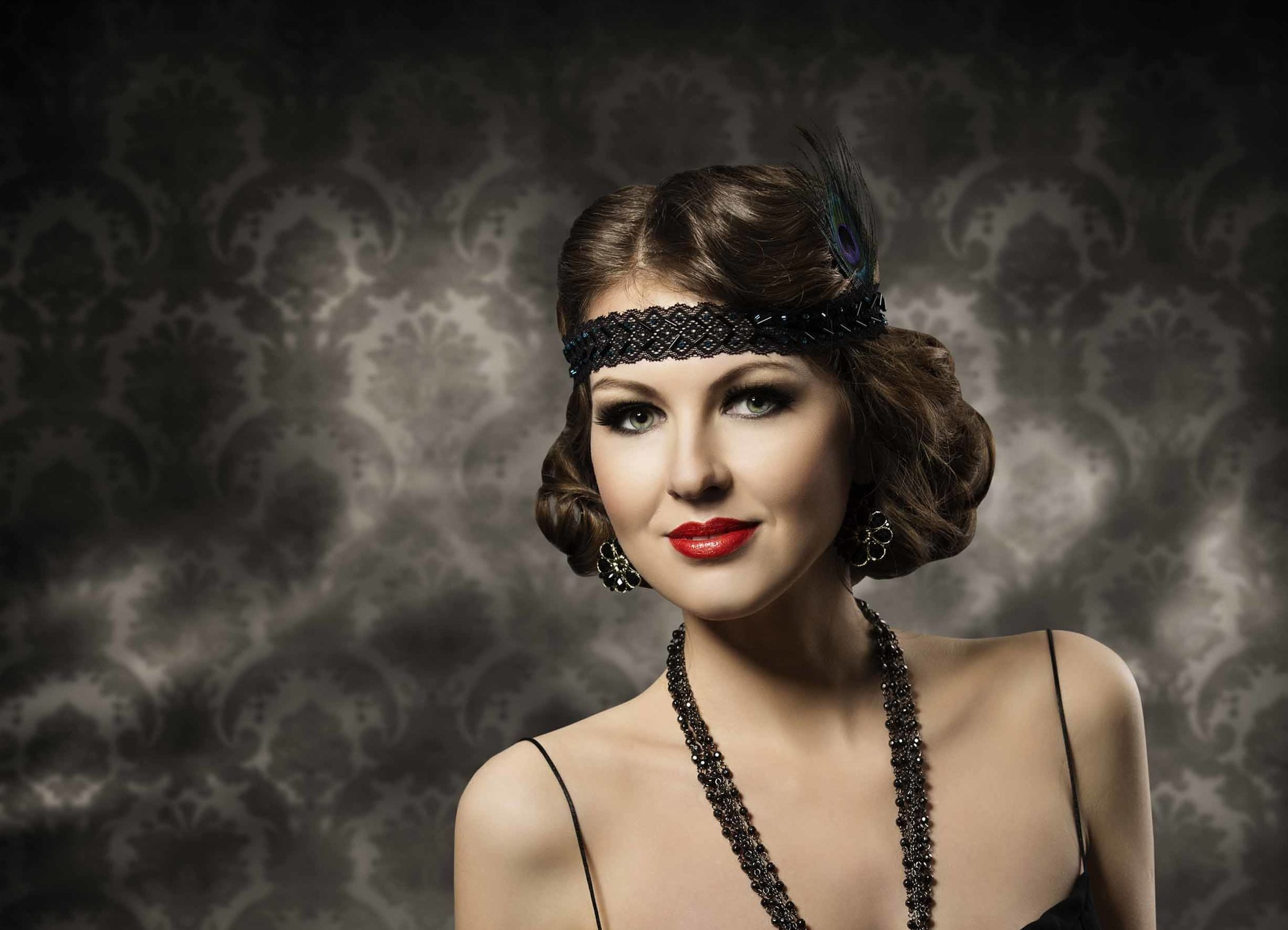 Brunette model with a 1920s short bob and finger waves with lace headpiece