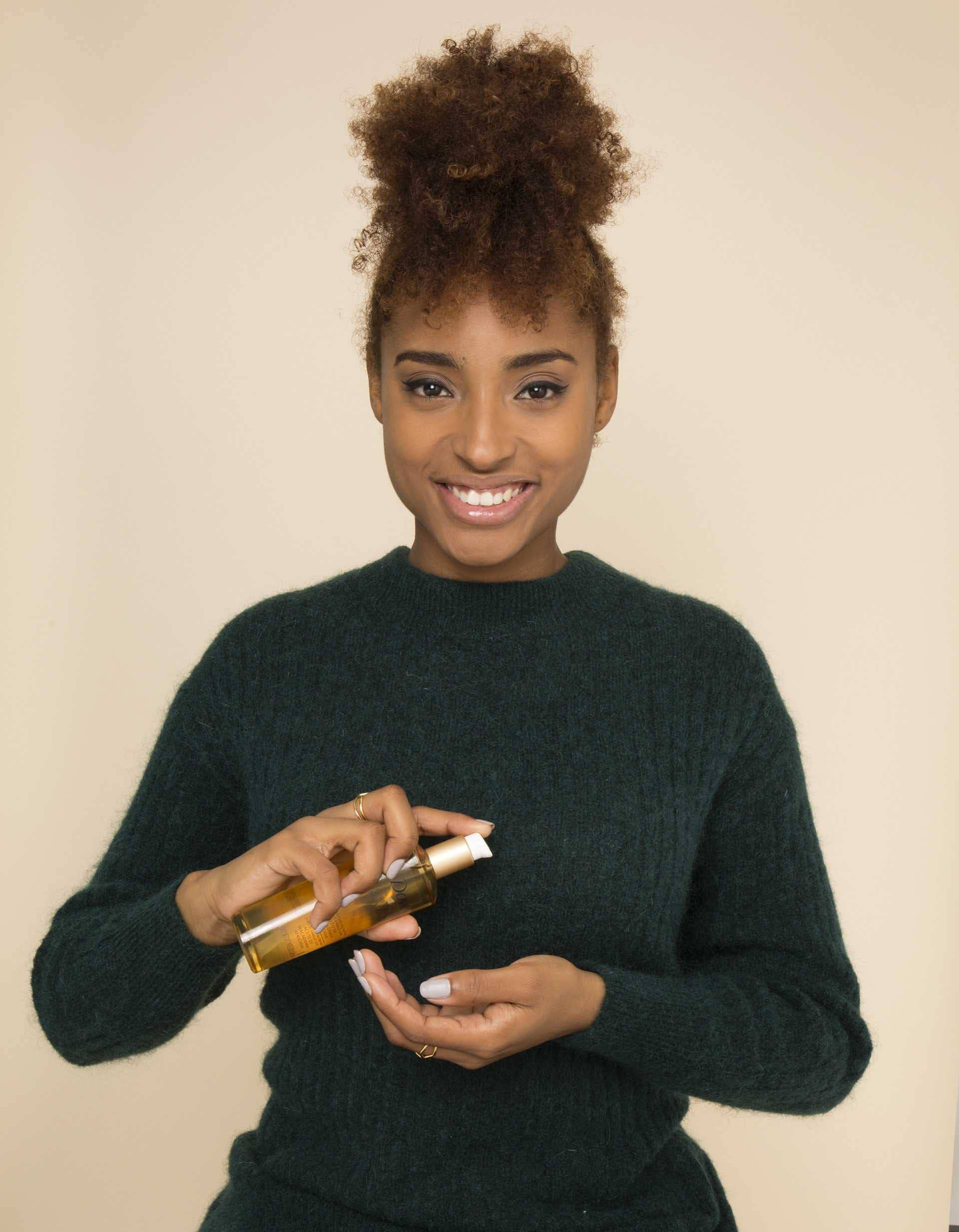 Natural hair frohawk: All Things Hair - IMAGE - apply oil
